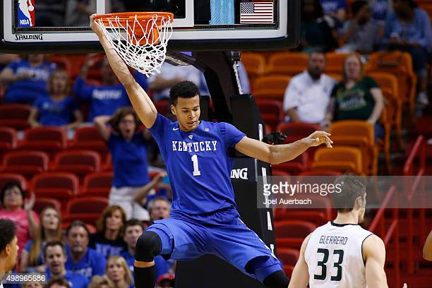 Skal Labissiere of the Kentucky Wildcats hangs on the basket after being fouled on the way up by the South Florida Bulls on November 27 2015 at the...