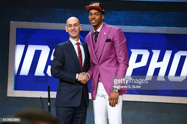 Skal Labissiere shakes hands with NBA Commissioner Adam Silver after being selected number twenty eighth overall by the Phoenix Suns during the 2016...