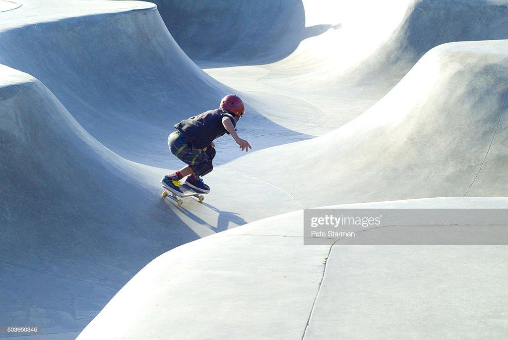 Skate boarder at skate park.