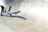 Skate boarder falling off skate baord.