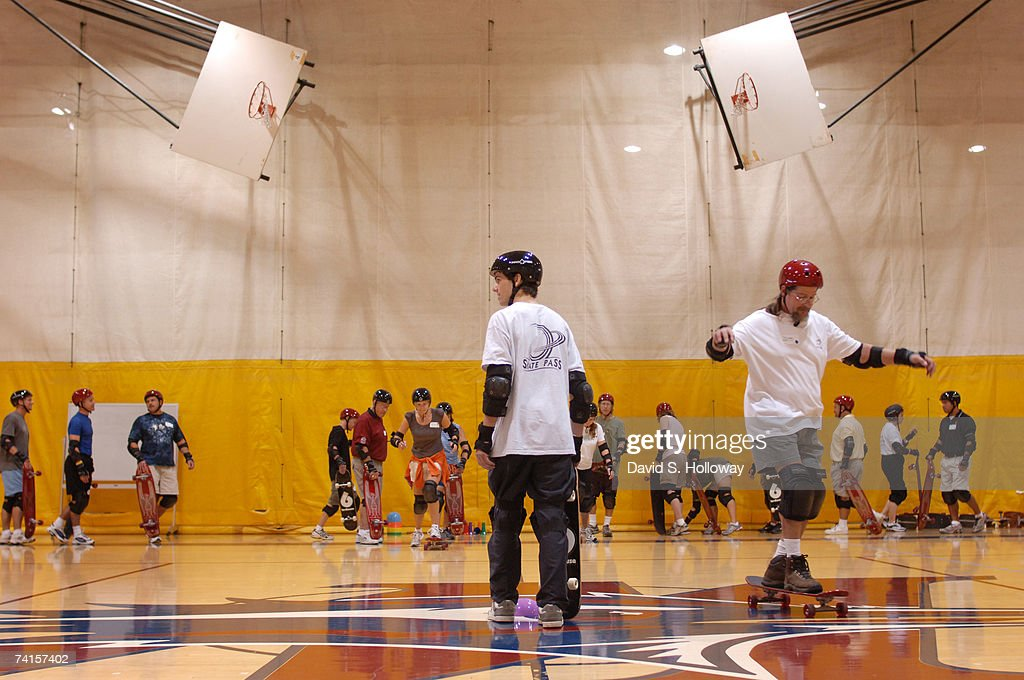 'Skate Pass' co-founder Eric Klassen, center, watches teachers ride during Skate Pass classes taught at the Physical Education and Dance Summer Institute held at Metro State College on June 12, 2006 in Denver, Colorado. The Skate Pass program, designed by Eric Klassen and Eva Mullen, is a three-part curriculum that teaches beginning, intermediate, and advanced skateboarding to elementary, middle school, and high school students. The program was first adopted by P.E. teacher Richard Cendali at Douglass Elementary School in Boulder, Colorado. Cendali, who is American Physical Education Teacher of the Year, first learned to ride a skateboard at age 59.