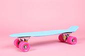 Skateboard on pink background