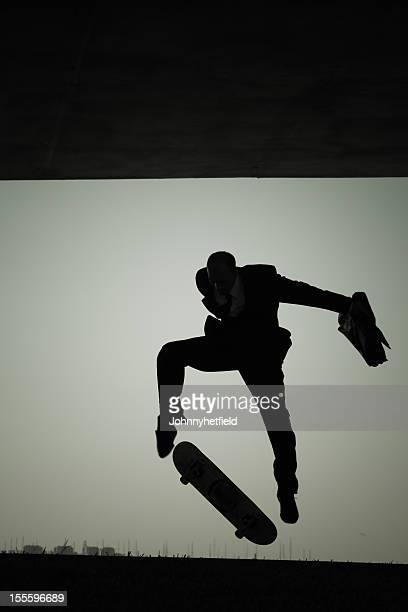 Skateboarder businessman in a suit