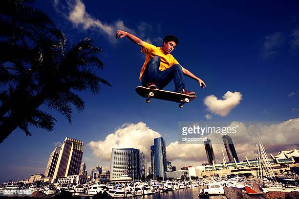 Skateboarder flying over San Diego