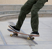 Skateboarding at Venice Skate Park at Venice Beach, Los Angeles CaliforniaSkateboarding at Venice Skate Park at Venice Beach, Los Angeles California