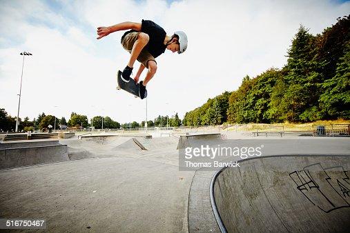 Skateboarder in mid air in skate park