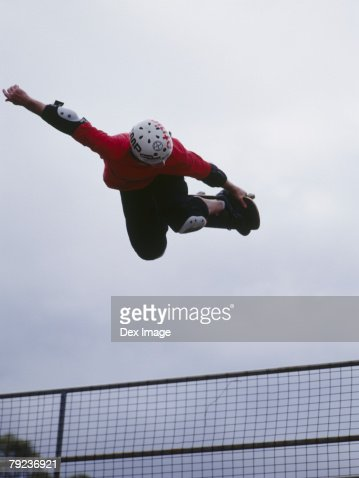 Skateboarder in mid air : Stock Photo