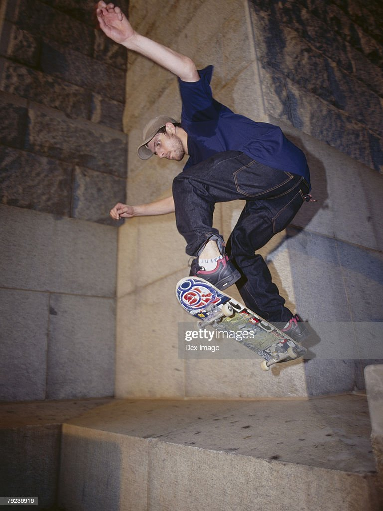 Skateboarder in mid-air : Stock Photo