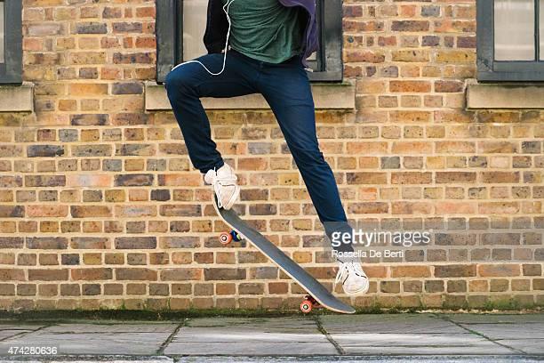 Skateboarder In Urban Environment