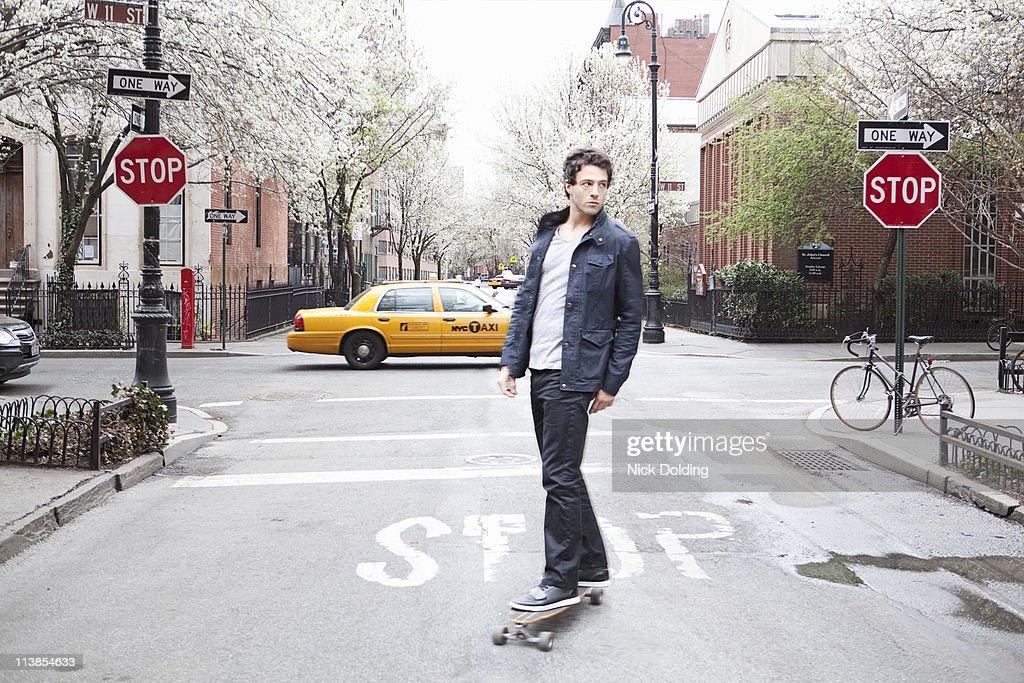Skateboarder in West Village : Stock Photo