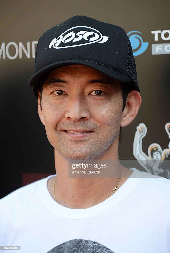 Skateboarder Lincoln Ueda arrives at the 9th Annual Stand Up For Skateparks Benefiting The Tony Hawk Foundation at a private residence on October 7, 2012 in Beverly Hills, California.