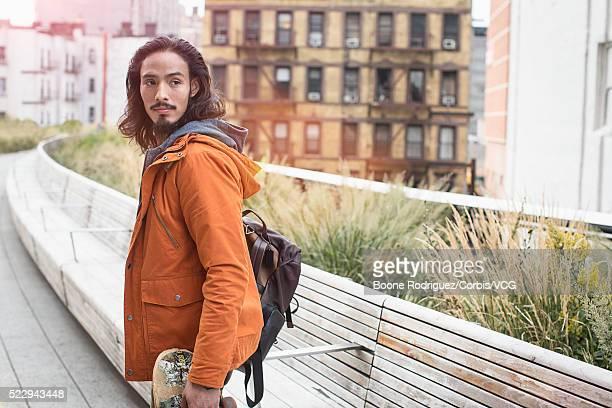 Skateboarder looking over his shoulder