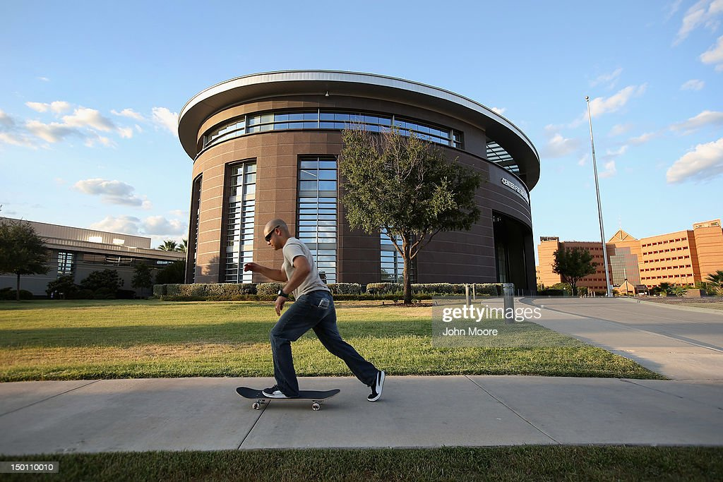 A skateboarder passes by the Center for the Intrepid (CFI), rehabilitation center at Brooke Army Medical Center on August 9, 2012 in San Antonio, Texas. Thousands of U.S. military war wounded, most suffering from amputations, spend months, if not years, in outpatient care at the center.