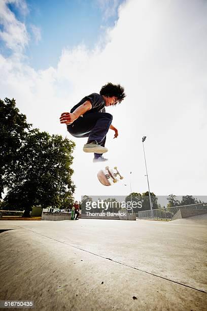 Skateboarder performing a kick flip in mid air