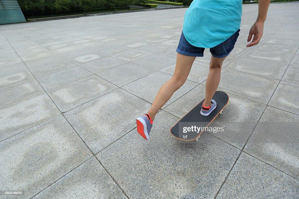 skateboarder skateboarding at  city : Stock Photo