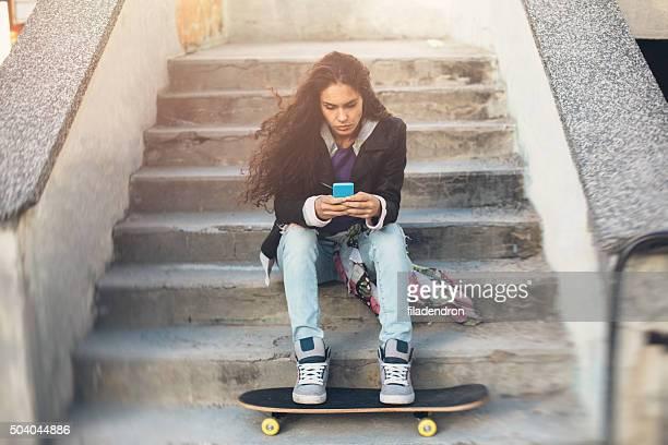 Skateboarder Texting