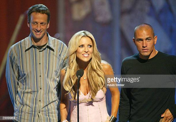 Skateboarder Tony Hawk actress Jillian Barberie and surfer Kelly Slater present for Choice Male Hottie at The 2003 Teen Choice Awards held at...