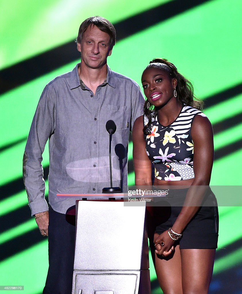 Skateboarder Tony Hawk (L) and tennis player Sloane Stephens speak onstage during Nickelodeon Kids' Choice Sports Awards 2014 at UCLA's Pauley Pavilion on July 17, 2014 in Los Angeles, California.