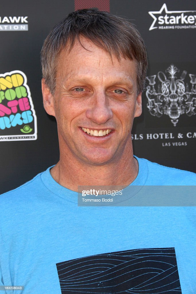 Skateboarder <a gi-track='captionPersonalityLinkClicked' href=/galleries/search?phrase=Tony+Hawk+-+Skateboarder&family=editorial&specificpeople=201818 ng-click='$event.stopPropagation()'>Tony Hawk</a> attends the 10th annual <a gi-track='captionPersonalityLinkClicked' href=/galleries/search?phrase=Tony+Hawk+-+Skateboarder&family=editorial&specificpeople=201818 ng-click='$event.stopPropagation()'>Tony Hawk</a>'s Stand Up For Skateparks celebrity charity event on October 5, 2013 in Beverly Hills, California.