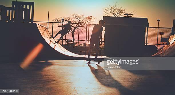 Skateboarders at dusk