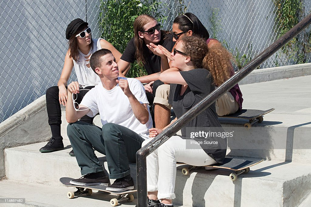 Skateboarders hanging out on on steps : Stock Photo