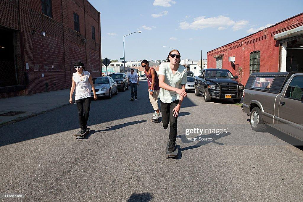 Skateboarders on urban street : Stock Photo