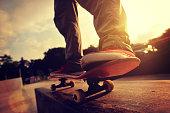 skateboarding legs sunrise skatepark