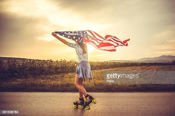 Pattinaggio ragazza con bandiera
