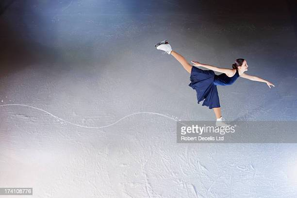 Skater making edge in ice, showing path.