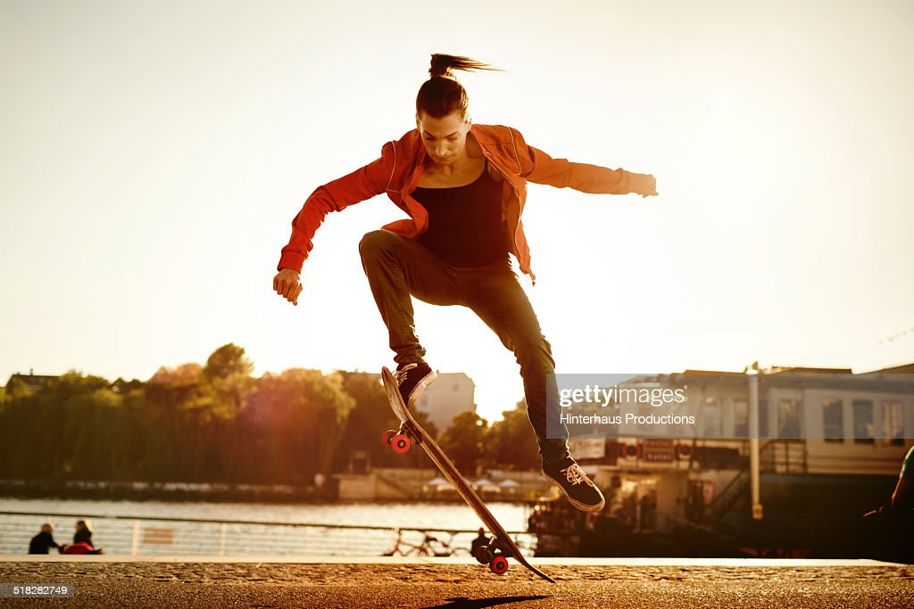 Skater Woman Jumping : Stock Photo