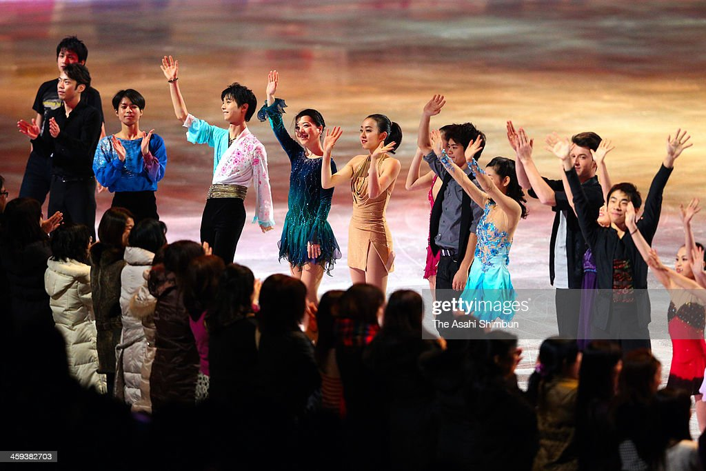 Skaters applaud the crowd after the gala exhibition during day four of the 82nd All Japan Figure Skating Championships at Saitama Super Arena on December 24, 2013 in Saitama, Japan.