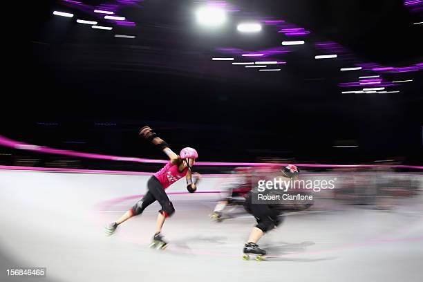Skaters compete during the Roller Derby Extreme between the LA Derby Dolls and the New York Gotham Girls at Hisense Arena on November 23 2012 in...
