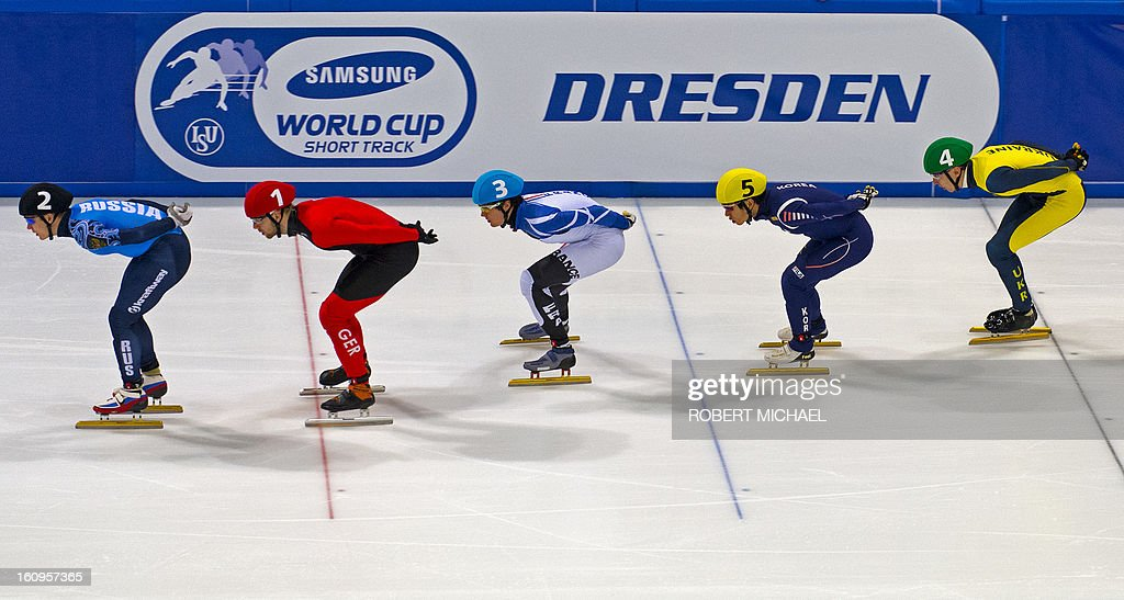 Skaters compete in the men's 1500m heat race of the ISU World Cup short track speed skating event in Dresden, eastern Germany, on February 8, 2013. AFP PHOTO / ROBERT MICHAEL