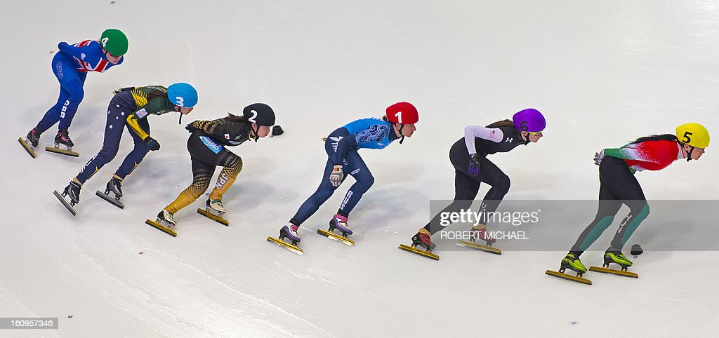 Skaters compete in the women's 1500m heat race of the ISU World Cup short track speed skating event in Dresden, eastern Germany, on February 8, 2013. AFP PHOTO / ROBERT MICHAEL