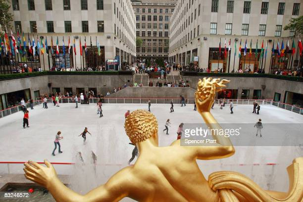 Skaters glide around the rink at the Rockefeller Center ice rink on its opening day for the winter season on October 13 2008 in New York City...