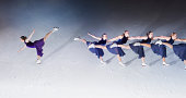 Skaters  in one direction, one skating in another.