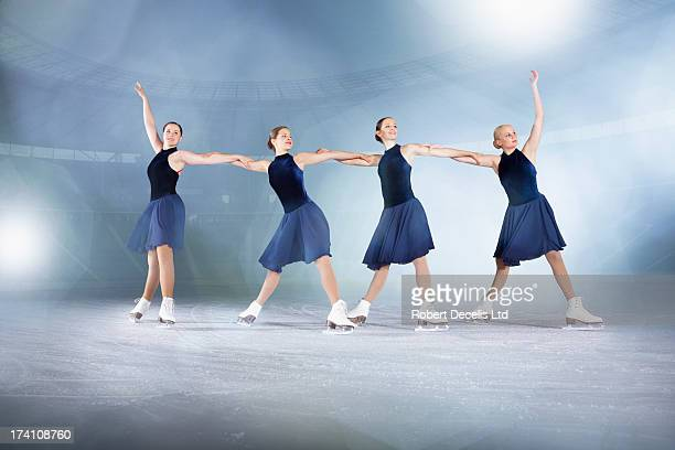 Skaters performing routine.