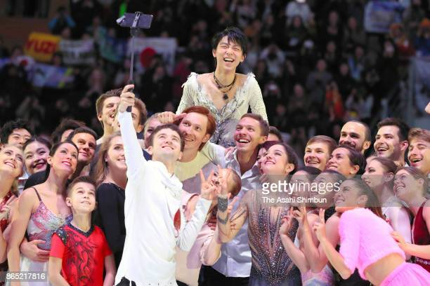 Skaters pose for selfie in the gala exhibition during day three of the ISU Grand Prix of Figure Skating Rostelecom Cup at Ice Palace Megasport on...