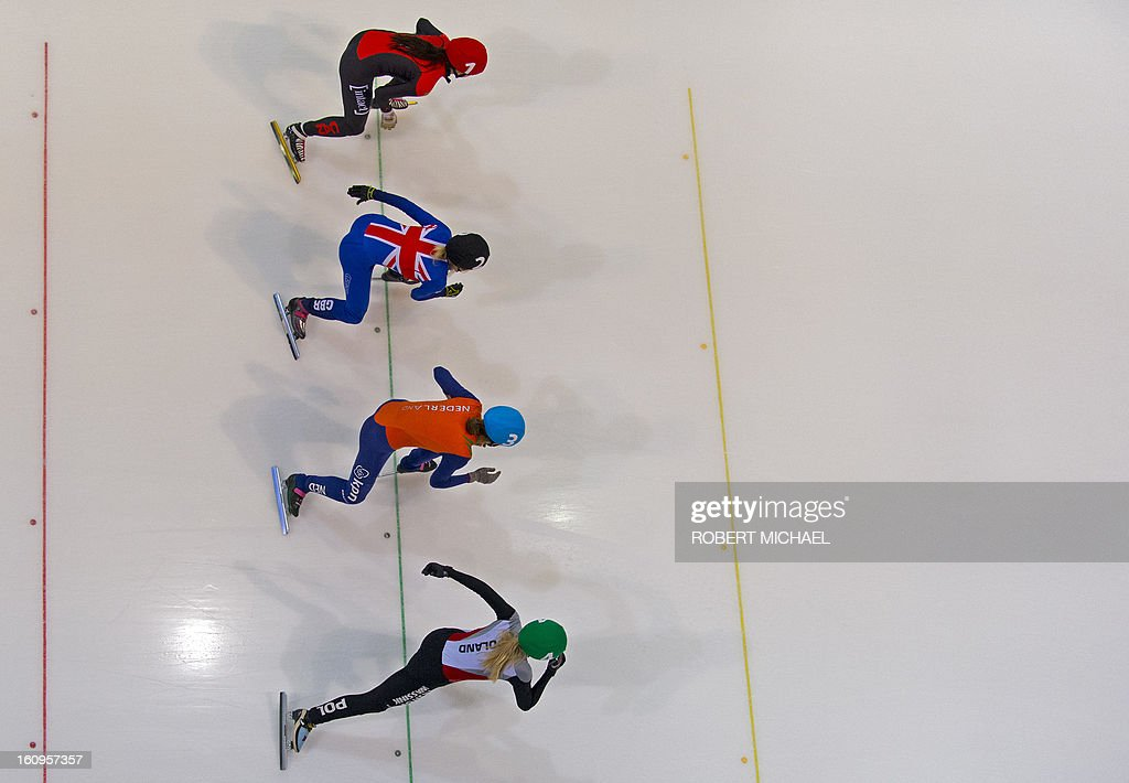 Skaters take the start in the women's 1500m heat race of the ISU World Cup short track speed skating event in Dresden, eastern Germany, on February 8, 2013. AFP PHOTO / ROBERT MICHAEL
