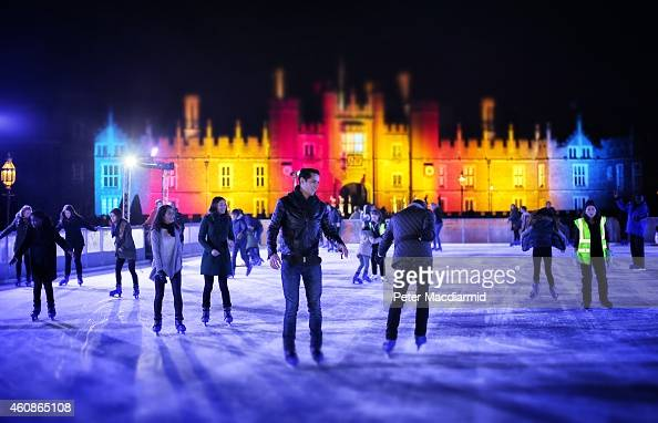 Skaters take to the ice at night at the ice rink at Hampton Court on November 29 2014 in London England Currently 12 seasonal ice rinks function...