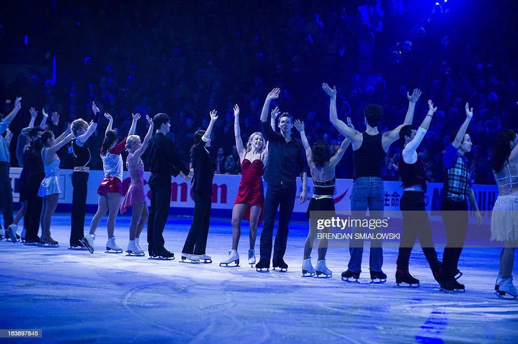 Skaters wave during the exhibition program at the 2013 World Figure Skating Championships on March 17, 2013 in London, Ontario. AFP PHOTO/Brendan SMIALOWSKI