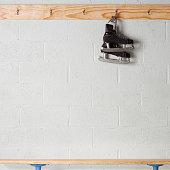 Skates Hanging in a Locker Room