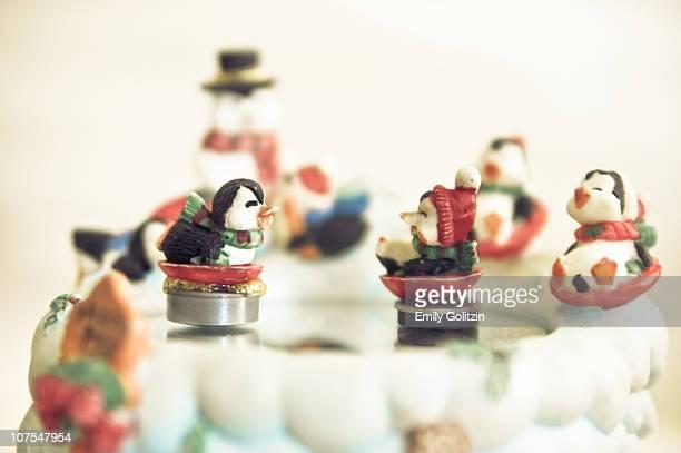 Skating penguin figurines