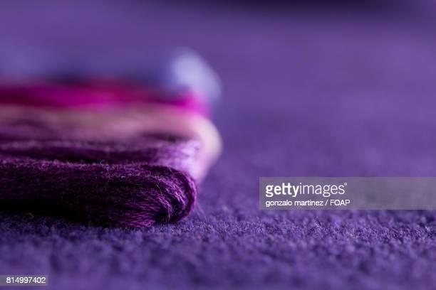 Skeins of purple thread of different tones