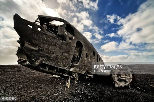 Skeletal remains of famous plane wreck on black sand beach in southern Iceland, dramatic skies