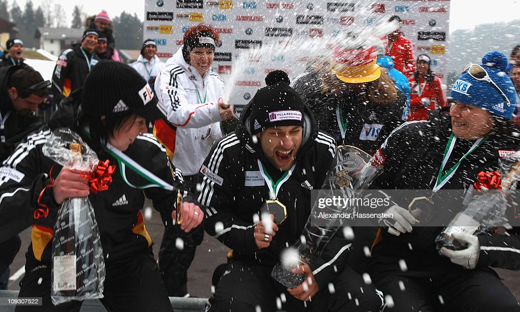 Skeleton athlete <a gi-track='captionPersonalityLinkClicked' href=/galleries/search?phrase=Anja+Huber&family=editorial&specificpeople=724605 ng-click='$event.stopPropagation()'>Anja Huber</a> (C) of team Germany 1 celebrates with champagne after the medal ceremony of the winning team Germany 2 with Marion Thees (L), Michi Halilovic (C, both Skeleton) and Bob pilot <a gi-track='captionPersonalityLinkClicked' href=/galleries/search?phrase=Sandra+Kiriasis&family=editorial&specificpeople=211078 ng-click='$event.stopPropagation()'>Sandra Kiriasis</a> (R) at the Team Competition World Championship on February 20, 2011 in Koenigssee, Germany.
