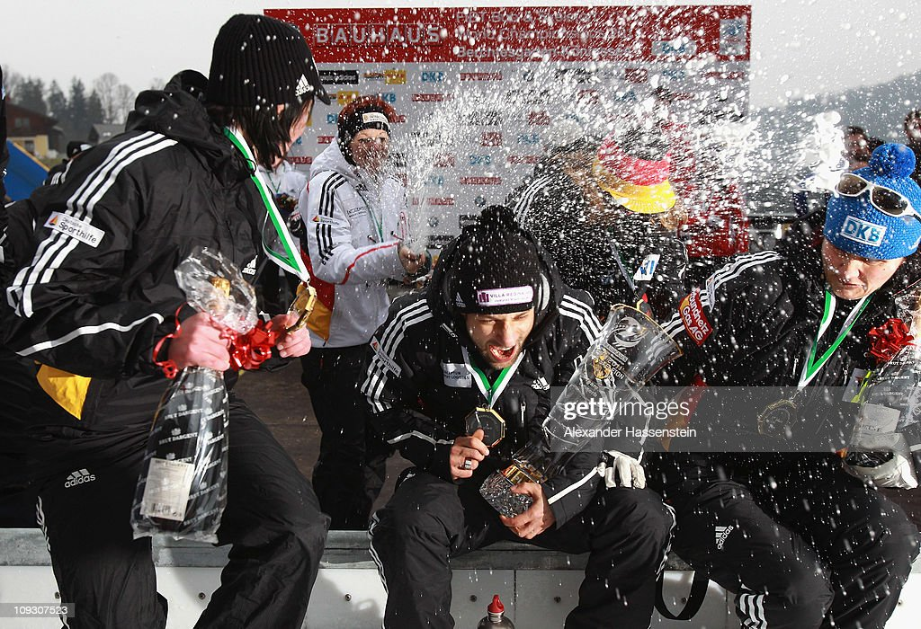 Skeleton athlete Anja Huber of team Germany 1 celebrates with champagne after the medal ceremony of the winning team Germany 2 with Marion Thees...