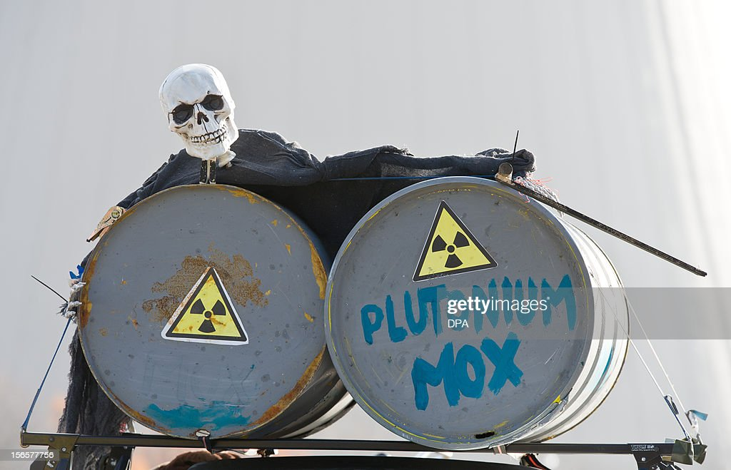 A skeleton is placed over two metal barrels on November 17, 2012 in Grohnde, eastern Germany, during a protest in front of the nuclear power plant against expected transport of so-called MOX fuel assemblies. AFP PHOTO/ Tobias Kleinschmidt/GERMANY OUT