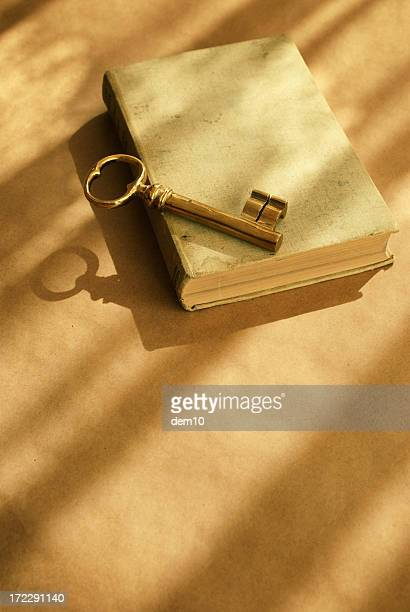 Skeleton Key on Stack of Tattered Books