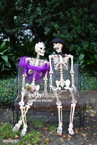 Skeleton man and woman at halloween